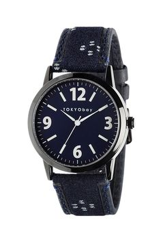 Deep blue fabric used on the straps is the result of traditional Indigo dyeing methods. A monochrome, sleek look with crisp white handset and index. Features battery operated JapaneseMiyotaquartz movement, tested at 3 ATM water resistance, brass case with IP black plated finish, Japanese Indigo dyed material & Italian leather, stainless steel case back, crown & buckle, and mineral glass lens.    Approx. Measures: 40mm case size       Fleck Watch by Tokyobay. Accessories - Jewelry…