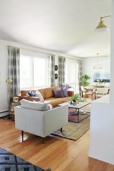 A Deserving Family Gets Living Room Makeover That S Comfortable And Reflects Coastal Cool Style