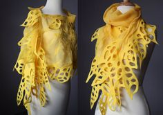 This could be easily made with a sheer scarf and some cut out felt sewn onto the edges.