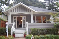 love the porch details, cottage style windows & color of this exterior