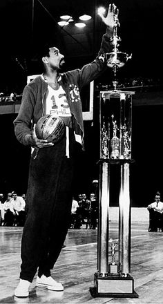 "7'1"" Wilt Chamberlain admires the 8'1"" trophy presented to him for becoming the NBA all-time leading scorer in 1966:"