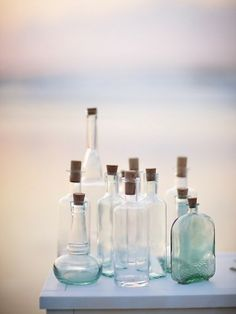 love these vintage bottles with a coastal feel, blues and clear and a beautiful background x