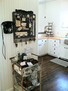 the magnet board was a former metal table top. it had a cove on one end where a piece of weathered lumber fit and some railroad date nails {from 1933!} found a home as a spot for items to hang out.