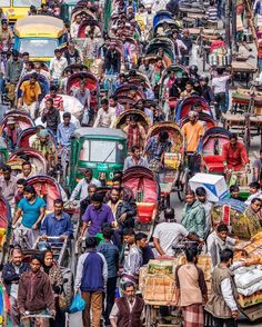 Rickshaw Rodeo II Old Dhaka Bangladesh  Endlessly fascinating to watch the traffic stream by. by ventureforthphoto