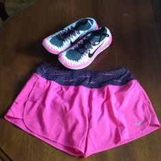 Nike women's rival short in pink Super cute and very comfortable. NIKE dri fit keep you dry material in a running short. Pink with a black band with dark pink tiny dots Nike Other