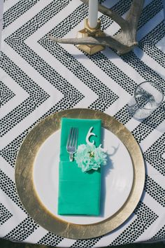 black & white chevron linens with gold, white, & aqua placesetting