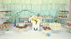 I would definitely style the dessert table differently but the ombre backdrop is gorgeous!