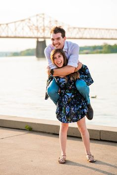 We've all seen poses where the guy is carrying the girl...not this couple, she can carry her man, too!   See more from their fun-filled engagement sessions on the blog.  #engagementphotography #engagementinspo #louisville