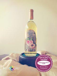 Cheers to that! The Best of Class Fruit Wine belongs to Ladoga Ridge Winery's Peach wine.