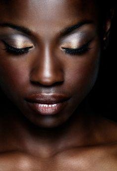 dark skin silver eyes- very dramatic