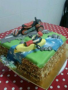 Kayak and motorbike cake