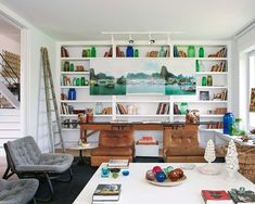 built-in shelving + art display + modern decor in living room via neuvo estilo