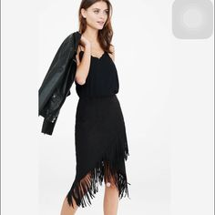 """Camel fringe wrap pencil skirt A supple, faux suede wrap skirt with ample, eight-inch fringe that swishes when you walk. Keep it simple and sexy with a shape-skimming ribbed sweater or go for a fully Southwestern vibe with a cami and denim jacket.  High waisted Hidden hook and zipper on side 8"""" fringe embellishment Wrap hem; Lined Polyester/Spandex body; Polyester lining Express Skirts Pencil"""