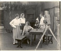 """Lois Weber, far left, with world-famous ballerina Anna Pavlova, seated, on the set of """"The Dumb Girl of Portici."""" It was the first blockbuster directed by a woman—Weber—and the only feature film in which Pavlova appeared."""