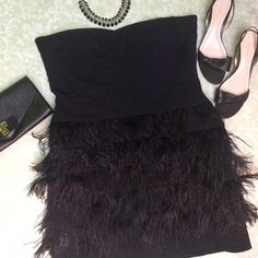 Ann Taylor ostrich feather dress Ann Taylor black strapless layered ostrich feather dress. Banded bodice with bustier construction. Sweetheart neckline. Side zipper with hook and eye closure. There are a few places on the front and side, pictured, that are a little sparse with the feathers. Size is 14. Ann Taylor heels available in a separate listing. Not interested in trades. Ann Taylor Dresses Strapless