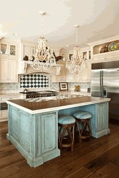 Loose the lighting fixtures, add butcher block to island and change the back splash and you've got a winner.