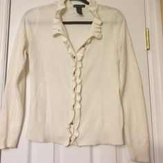 Cream ruffle trim cardigan Pretty and practical! Lovely marquisate type silver buttons make this cardigan perfect for the office and the after party  ... Light but warm material perfect to throw over a tank or dress! 100% Acrylic. Good condition. Some pilling but no stains or damage. New York & Company Sweaters Cardigans