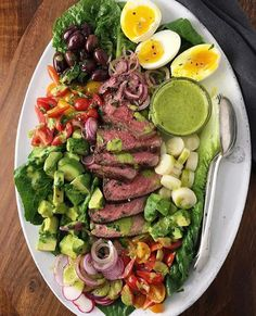 Spring is here and we're pretty excited about these seasonal ingredients! Here is a divine option from @nocrumbsleft that starts with a grilled strip steak or any steak softly cooked eggs chopped tomatoes avocado hearts of palm and radishes then drizzled with an avocado cilantro dressing. . What's your favorite Spring ingredient?