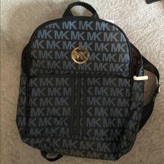 Micheal Kors Backpack- Gunmetal gray Never used Micheal Kors backpack still with tags! Great condition and super cute for casual or dressy occasions! Michael Kors Bags Backpacks