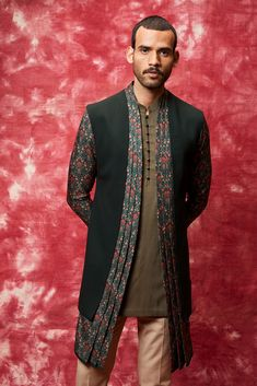 Front Open Printed Draped Style Nehru jacket with Short Kurta along with Trousers!  #EhsaasByQbik, the collection is ideal for cheery day functions and intimate weddings. Get your Amazing Qbik menswear piece from, now! Contact us now 07931 999111 or email us at contact@bibilondon.com to book your Consultation, for bespoke and customized services by our experienced team! #menswear#IndianCouture #bibilondon #qbik#bibildn #indiancouture #indiansuit #qbikatbibilondon #nehrujacket #kurta Mens Indian Wear, Indian Groom Wear, Indian Suits, High Fashion Men, Indian Men Fashion, Nehru Jackets, Long Jackets, Mens Traditional Wear, Mens Kurta Designs