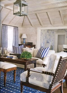 Washed wood ceiling and blue and white stripes just say beach to me!