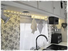 love the rope lights over the sink and lots more from this little camper
