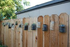 15 Fence Planters That'll Have You Loving Your Privacy Fence Again Privacy Fence Decorations, Privacy Fence Landscaping, Backyard Privacy, Diy Fence, Backyard Landscaping, Fence Hanging Planters, Herb Planters, Hanging Plants, Tiered Garden