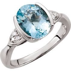 Aquamarine and diamond accented ring.  Available from DJ's Jewelry, in Woodland. www.DJsJewelry.com