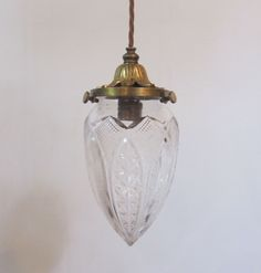 English pendant light in the original brass finish complete with period cut glass shade. c 1900  www.antiquelightingcompany.com