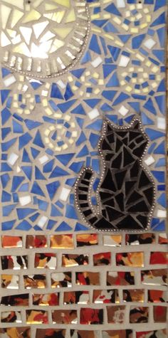 My latest piece made from stained glass and ball chain. Black cat mosaic wall plaque.  Donated to art auction for Memphis Pets Alive rescue group.