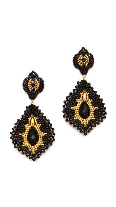 Miguel Ases ~ Brilliant gold seed beads adorn the twinkling onyx pendants swinging from post earrings