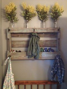 Coat rack made from a pallet, with storage for little hats and gloves. :-)