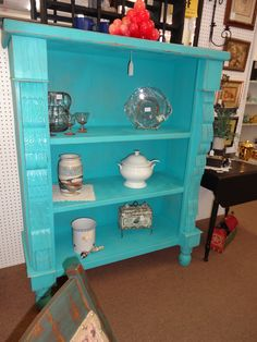 SOLD - This large pine shelving unit is deeply carved with big chunky feet - painted and distressed. ***** In Booth D3 at Main Street Antique Mall 7260 E Main St (east of Power RD on MAIN STREET) Mesa Az 85207 **** Open 7 days a week 10:00AM-5:30PM **** Call for more information 480 924 1122 **** We Accept cash, debit, VISA, MasterCard or Discover