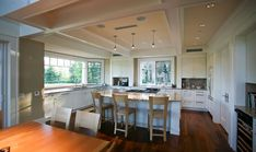 spacious kitchen with lots of windows