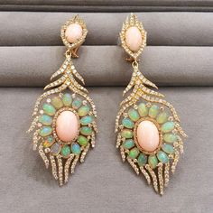 Swept away with the soft shades of pink mixed with delicate opalescence. Coral…