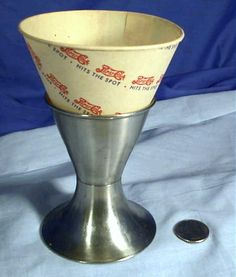 Paper funnel cup inserts in metal holders - you got your Coke often in one of these at the drugstore soda-fountain in the 50's. remember these.