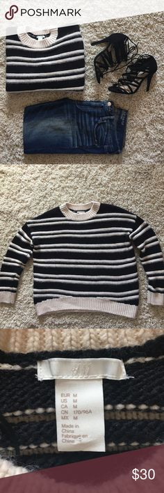 COLUMBUS DAY SALE H&M Black & White Sweater Black & White sweater. 90% Acrylic 10% Wool. Size M. Worn once. Fits wide. No snags. Looks adorable with skinny jeans and strappy sandals or knee high boots for fall. **jeans not for sale. H&M Sweaters Crew & Scoop Necks
