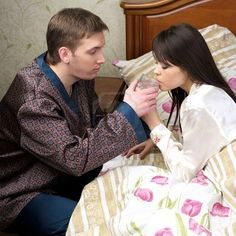 Picture of Attentive man give fresh water to sick woman at the bed stock photo, images and stock photography.
