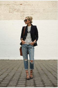 Black blazer, black and white top with distressed boyfriend jeans.