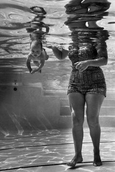 """The """"world's youngest swimmer,"""" Julie Sheldon, cruises underwater next to her grandmother, Mrs. Jen Loven, a children's swimming instructor in 1954 Los Angeles. (Ed Clark—The LIFE Picture Collection/Getty Images) 9 Week Old Baby, B&w Tumblr, Old Photos, Vintage Photos, Edward Clark, Shoulder Tattoos For Women, Photo D Art, Life Pictures, Picture Collection"""