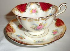 Sale ROYAL ALBERT EMPRESS Series - Catherine. Vintage China Tea Cup and Saucer Set in Ruby Red and Gold with Pink Roses and Pastel Flowers.. by PrettyVintageHome on Etsy https://www.etsy.com/ca/listing/257914288/sale-royal-albert-empress-series
