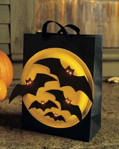 Light up your little ones' night -- and their bags -- with bright-eyed bats. Coat the bottom of a paper plate with bold, reflective paint.