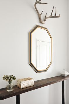 make a similar console table... Just Outside of Toronto, A Condo Filled With Things Loved | Design*Sponge
