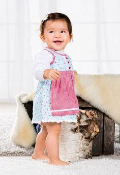 Dieses zarte Kinderdirndl von Bondi ist die ideale erste Trachtenmode für Ihre Kleine. Das geblümte Babydirndl ist besonders kindgerecht, denn es lässt sich sehr einfach durch Druckknöpfe am Rücken an- und ausziehen.