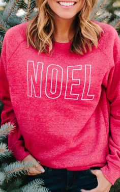 bbaac44d4 The Holiday Season is here and so is our Noel Sweatshirt! Pair this NOEL  sweatshirt with a skinny jeans for a perfect Holiday look.