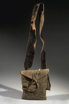 BRAVES FOOD BAG, BLACKFEET.  MT, GLACIER COUNTY?, BROWNING? HIDE, FUR, SINEW, PINE NEEDLES L:63.5 W:18.5 H:6.5 (in CM) Acquisition Year 1905.  Donor WISSLER, CLARK, DR. American Museum of Natural History.