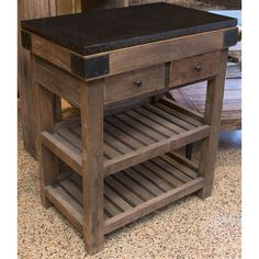 Butcher block island featuring a black granite top, two accessory drawers, two plank shelves and a metal towel rod. From a liquidation of select Bungalow Home inventory.