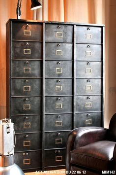 "Filing cabinet ""STRAFOR"" circa 1950, 24 gates, wide storage capacity, label holders brass, raw metal graphite."