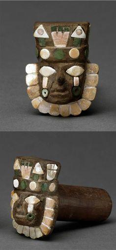 Peru | Huari earplugs with human head | 650 - 900 AD | Wood with stone and shell inlay