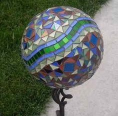 diy Garden Art How To: Lamp Globe with Marbles  Bowling ball garden art has become very popular in recent years, providing a durable, new twist on the classic gazing ball, which can be both expensive and very fragile.